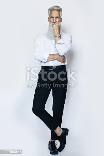 698023272 istock photo Handsome aged male model posing  on white background 1227560943