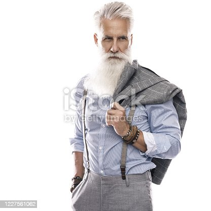 698023272 istock photo Handsome aged male model posing  on white background 1227561062