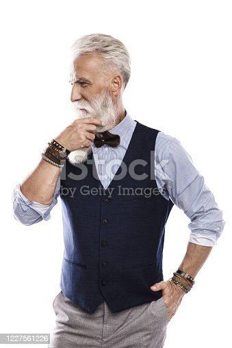 698023272 istock photo Handsome aged male model posing  on white background 1227561226