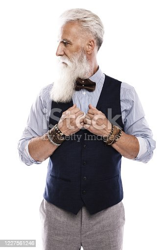 698023272 istock photo Handsome aged male model posing  on white background 1227561246