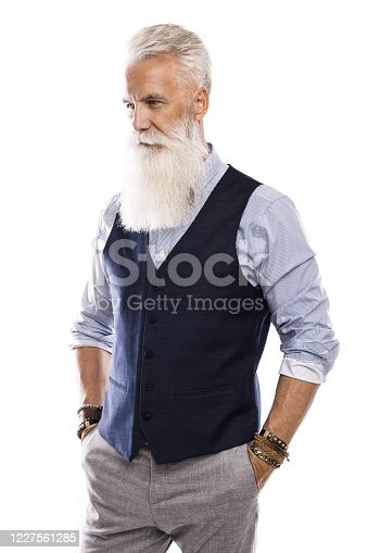 698023272 istock photo Handsome aged male model posing  on white background 1227561285