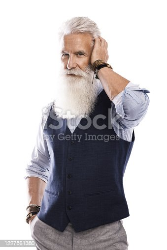 698023272 istock photo Handsome aged male model posing  on white background 1227561380
