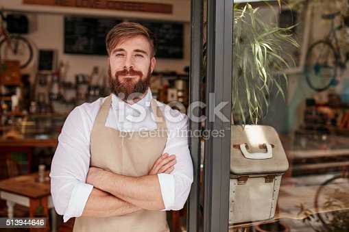 istock Handsome and confident cafe owner 513944646