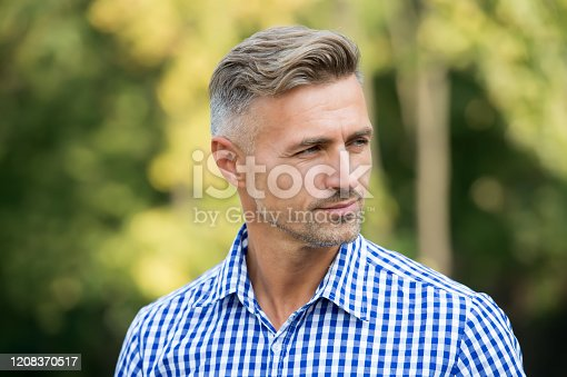 Handsome and confident. Handsome man on summer outdoor. Mature person with handsome face. Fashion and style. Grooming and style for older men. Handsome and well groomed.
