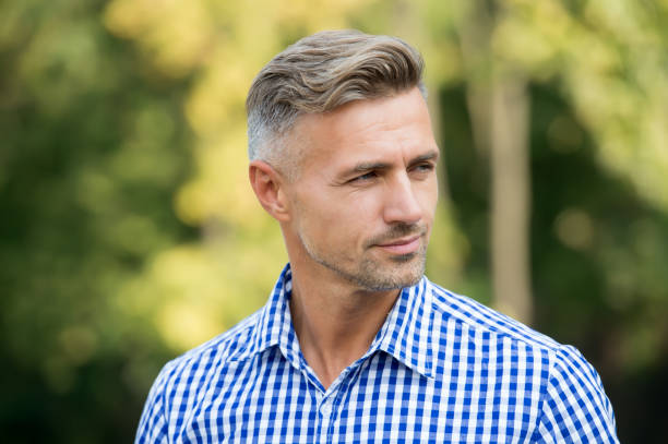 Handsome and confident. Handsome man on summer outdoor. Mature person with handsome face. Fashion and style. Grooming and style for older men. Handsome and well groomed stock photo