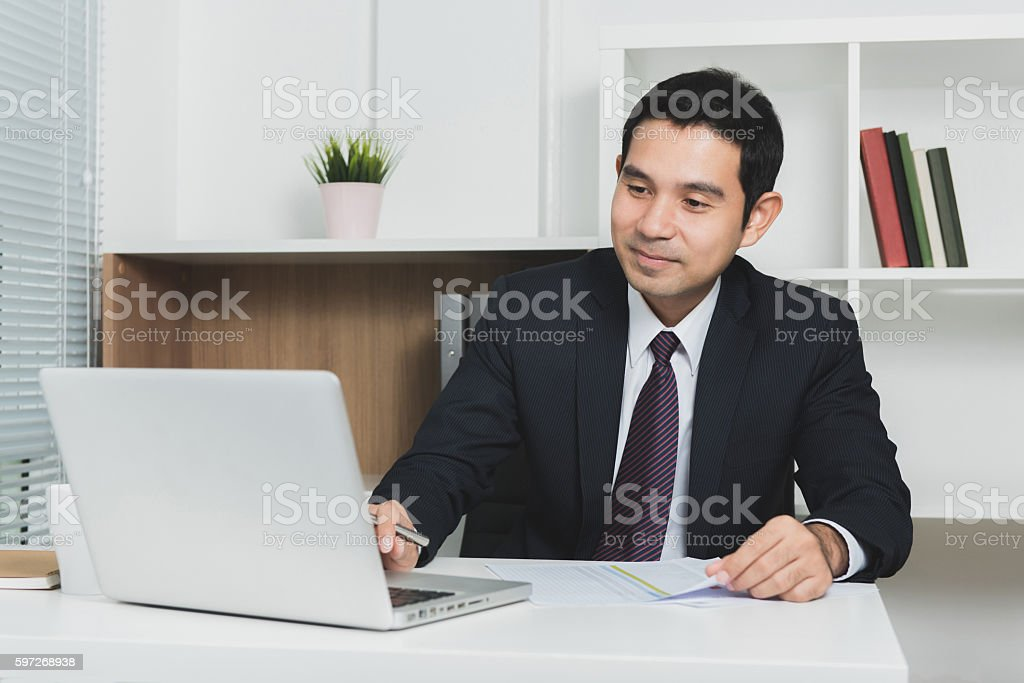 Handsome Asian businessman using laptop computer royalty-free stock photo
