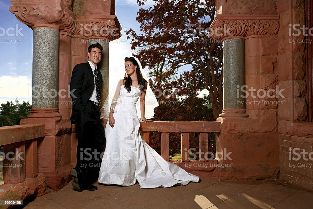 Handsome Asian Groom Smiling With Bride royalty-free stock photo
