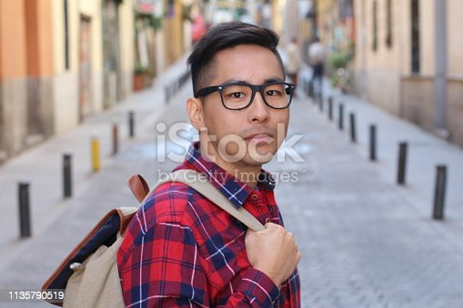Handsome asian man looking at camera.