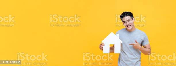Handsome asian man smiling and pointing to new house cutout picture id1191133305?b=1&k=6&m=1191133305&s=612x612&h=s5derfjkiy7bfd8 ipwhyrtyax4fdokmbnglc3whqe8=