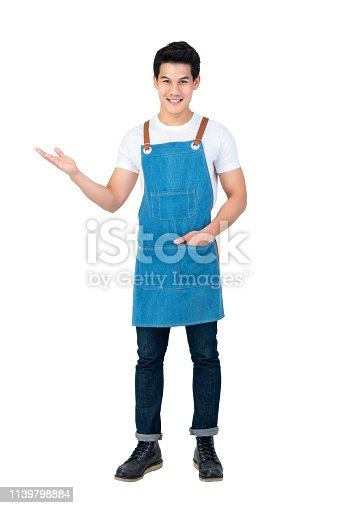 istock Handsome Asian man wearing apron with open hand 1139798884