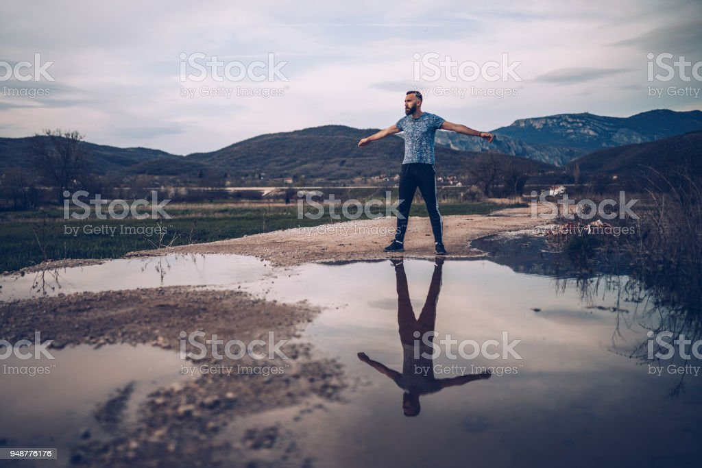 Handsome athlete exercising outdoors stock photo