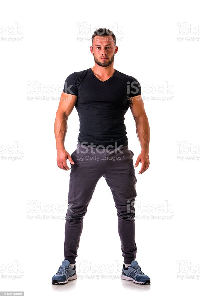 Handsome athletic man standing, isolated stock photo