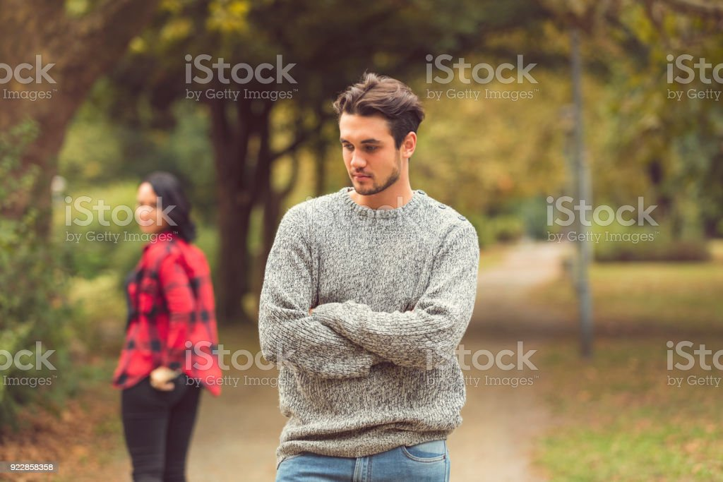 Handsome attractive man waiting for girlfriend outdoors. Love or break up concept. stock photo