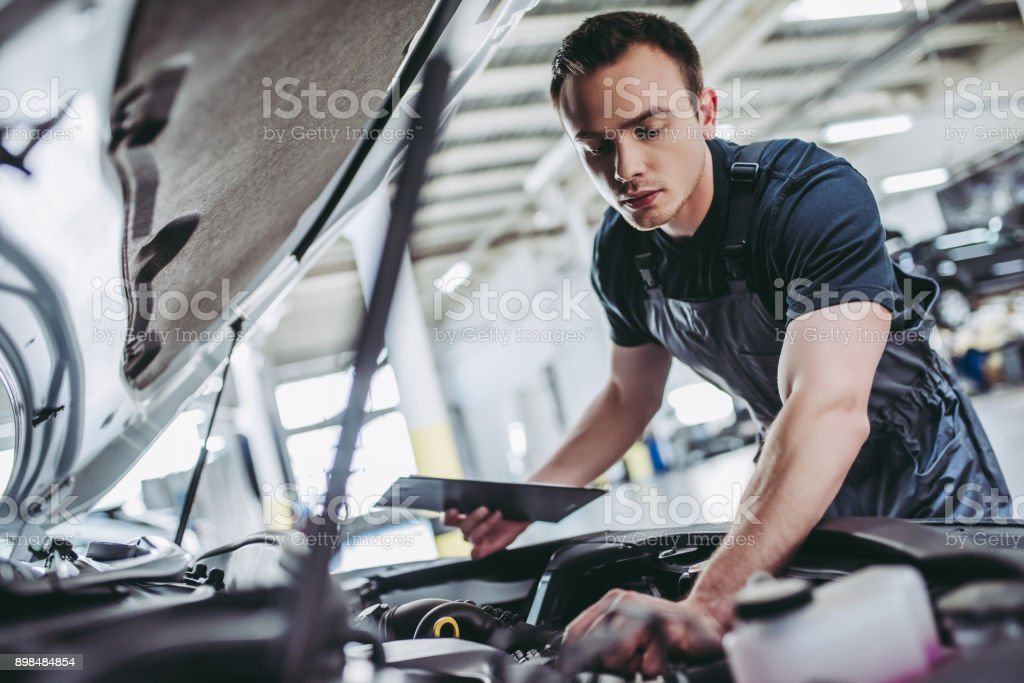 Handsome auto service mechanics. stock photo