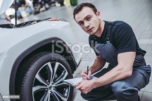 898487280 istock photo Handsome auto service mechanics. 898486998