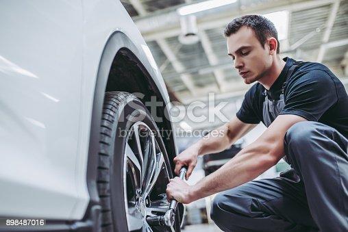 898487280 istock photo Handsome auto service mechanics. 898487016