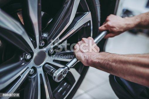 898487280 istock photo Handsome auto service mechanics. 898487018