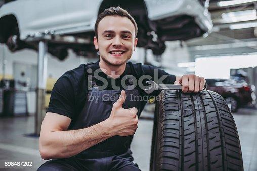 898487280 istock photo Handsome auto service mechanics. 898487202