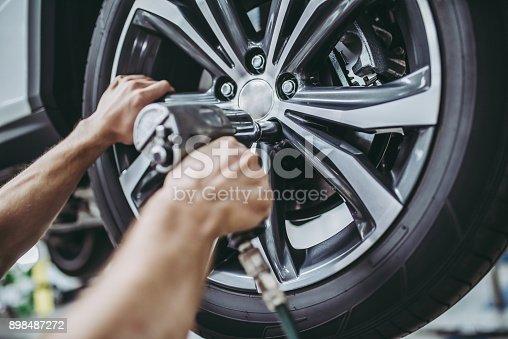 898487280 istock photo Handsome auto service mechanics. 898487272
