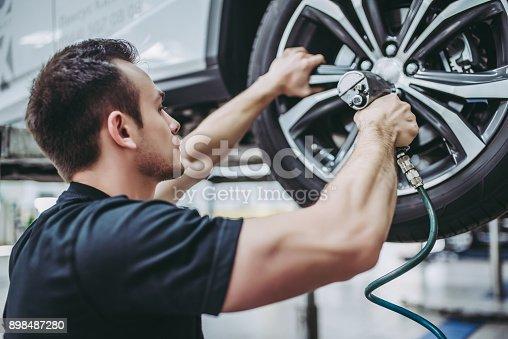 istock Handsome auto service mechanics. 898487280