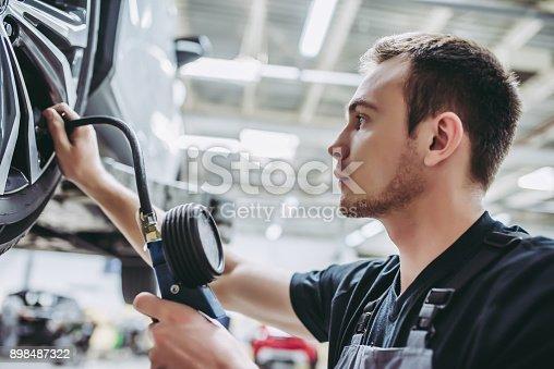 898487280 istock photo Handsome auto service mechanics. 898487322