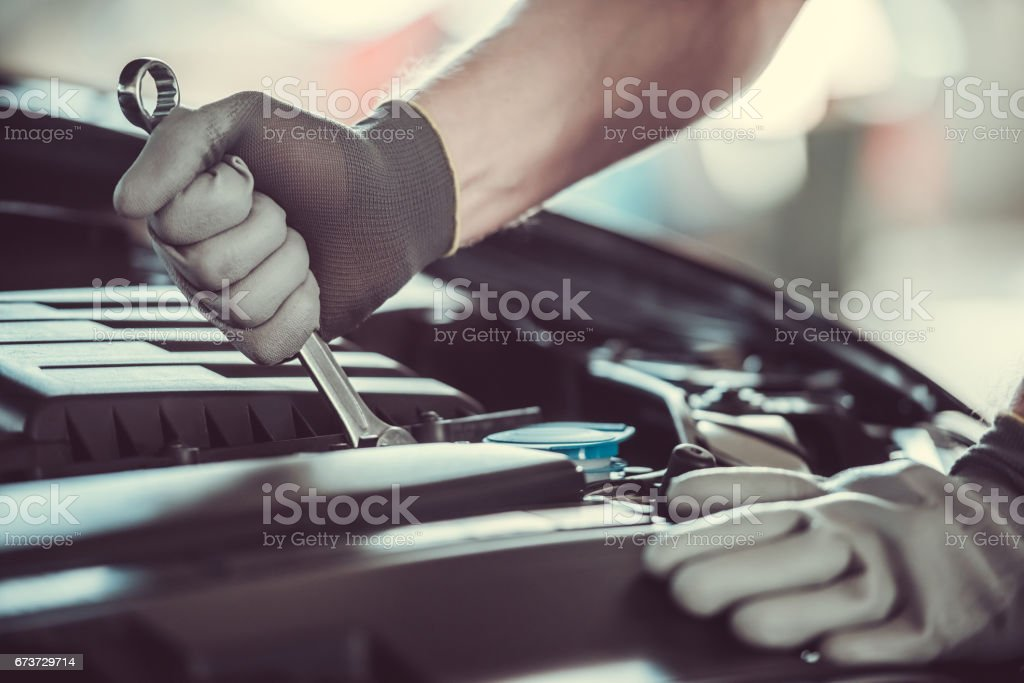 Handsome auto service worker royalty-free stock photo