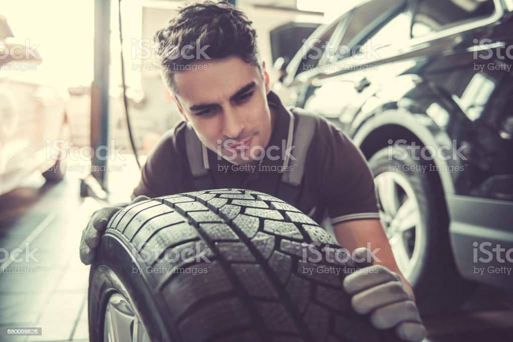 Handsome auto service worker stock photo