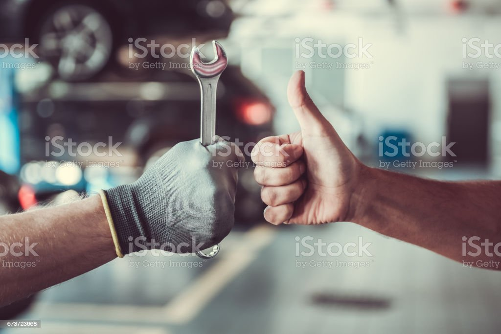 Handsome auto service workers stock photo