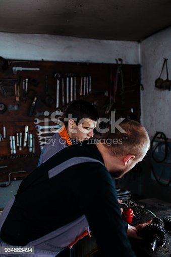 673723668 istock photo Handsome auto service workers 934883494