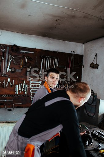 673723668 istock photo Handsome auto service workers 934884132