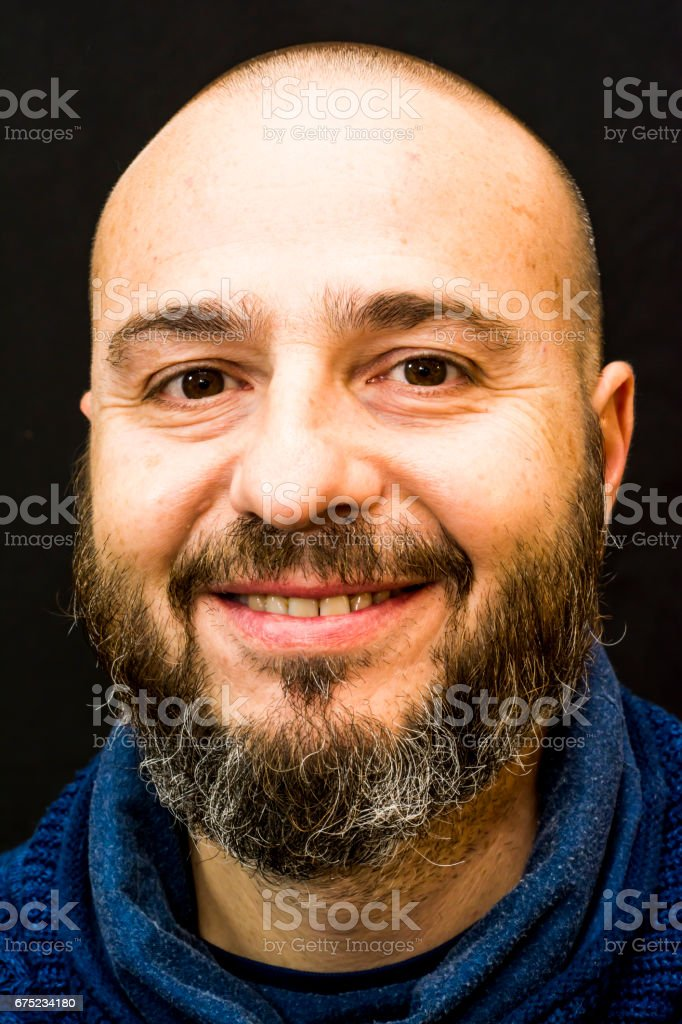 Handsome, bald man with beard on black background royalty-free stock photo