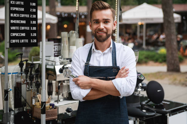 handsome barista man during work in his street coffee shop - small business saturday stock pictures, royalty-free photos & images