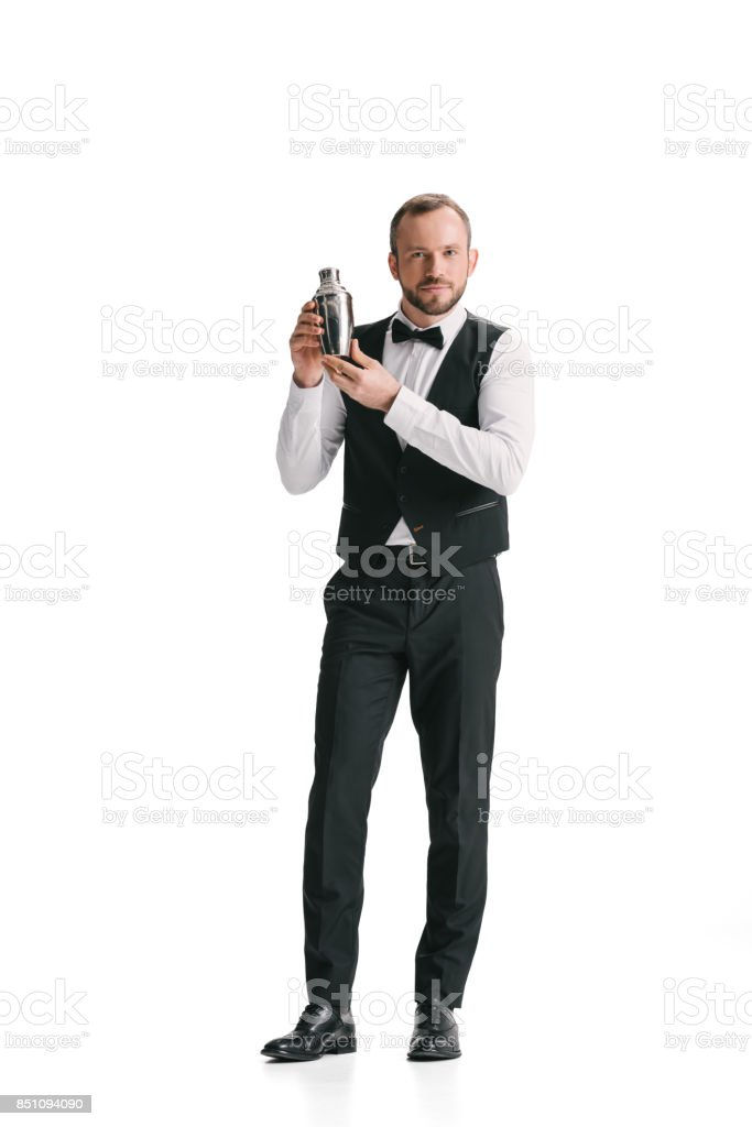 handsome bartender with shaker stock photo