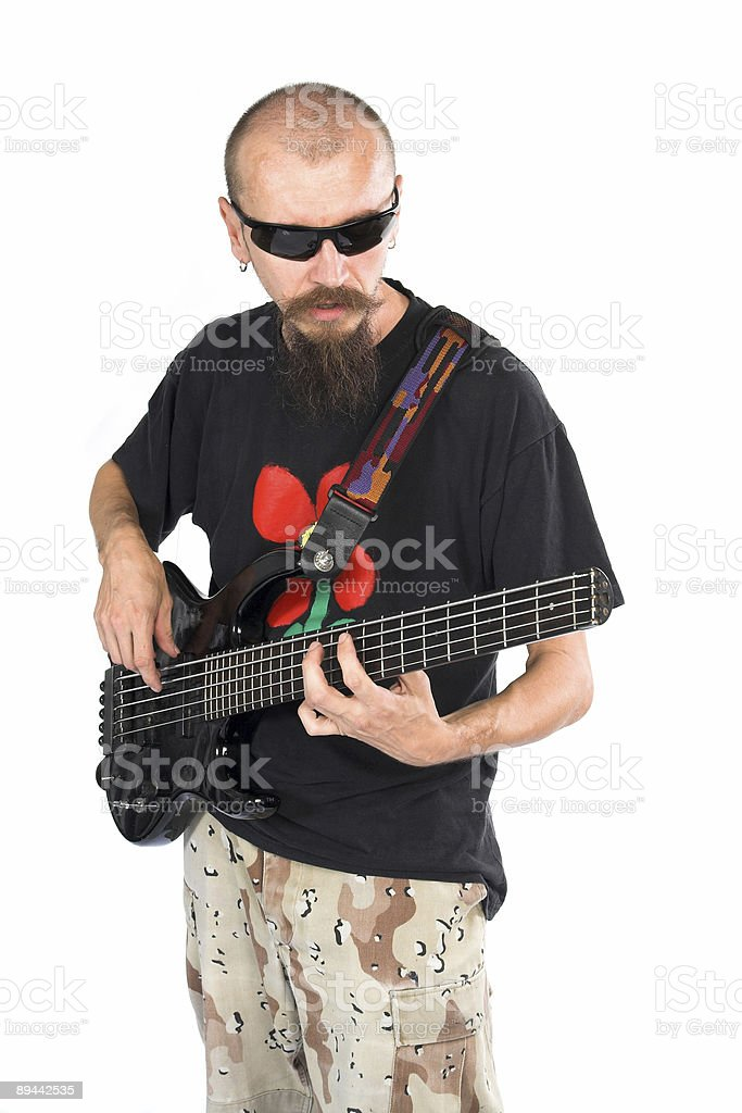 Handsome bass player royalty free stockfoto