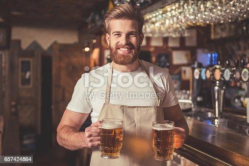 istock Handsome bearded bartender 657424864