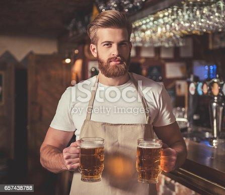 istock Handsome bearded bartender 657438788