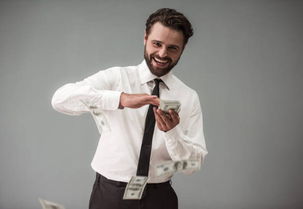handsome bearded businessman - throw money away stock pictures, royalty-free photos & images