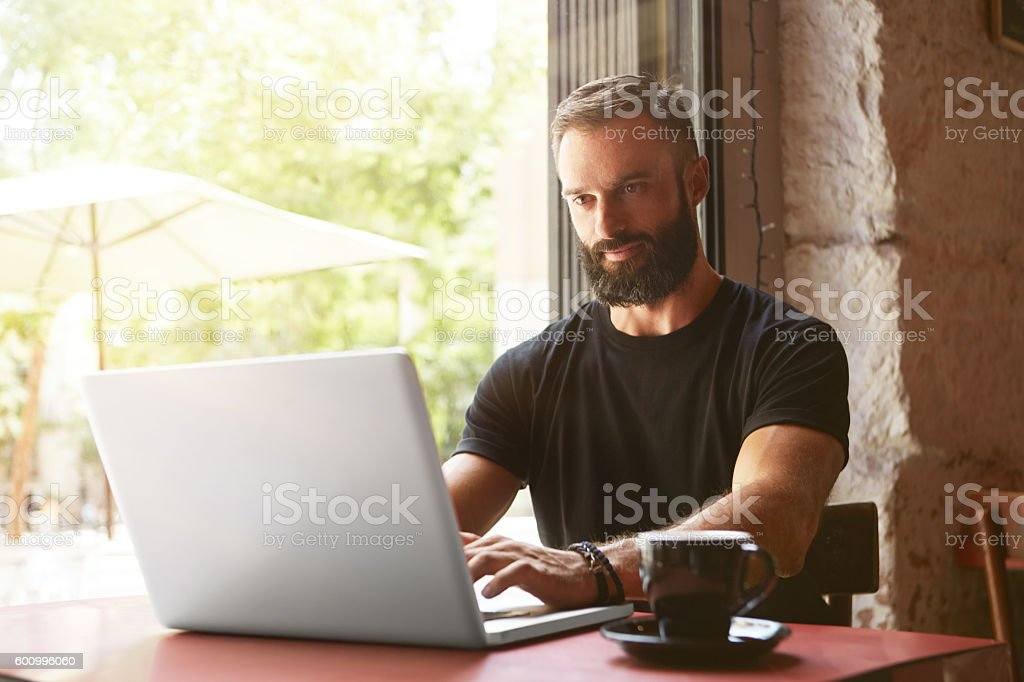 Handsome Bearded Businessman Wearing Black Tshirt Working Laptop Wood Table стоковое фото