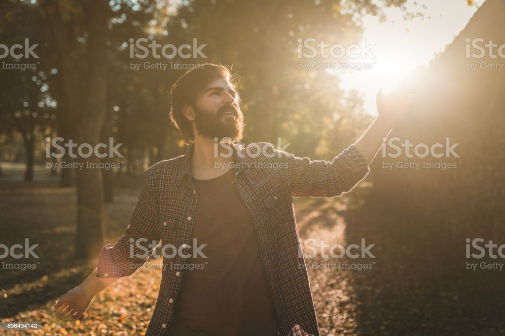 Handsome bearded hipster at the park stock photo