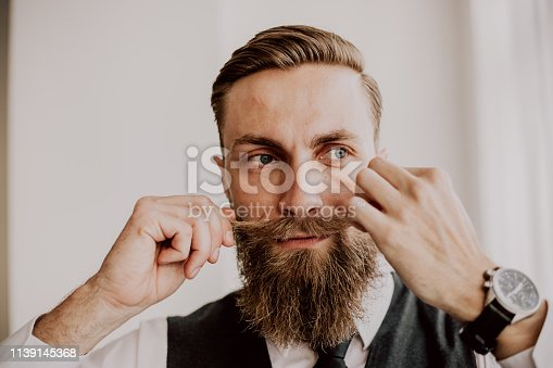 464621546 istock photo Handsome bearded hipster 1139145368