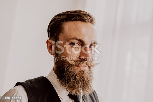 464621546 istock photo Handsome bearded hipster 1139145374