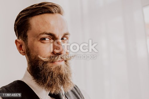 464621546 istock photo Handsome bearded hipster 1139145375