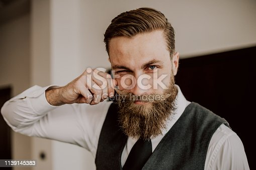 464621546 istock photo Handsome bearded hipster 1139145383
