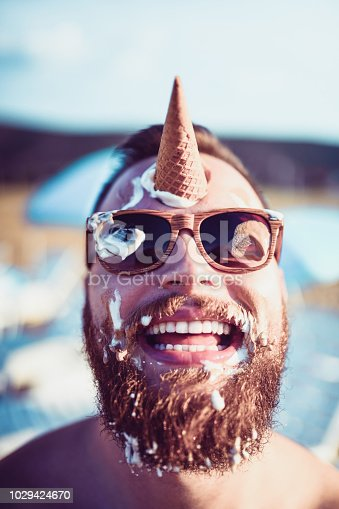 Handsome Bearded Male Playing With Ice Cream