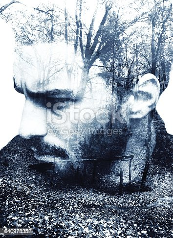 Double exposure of young handsome bearded man and autumn forest close up. Special toned image colors