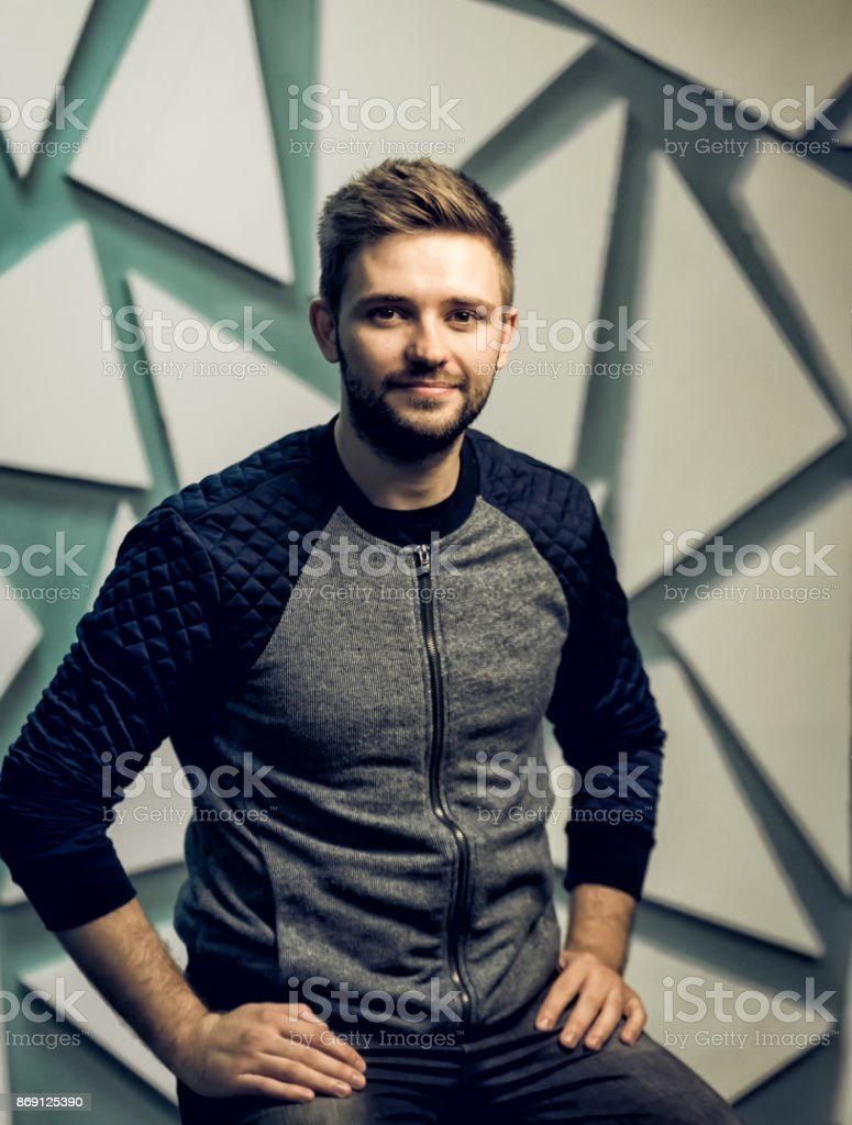 Handsome bearded man smiling and looking at the camera. Studio portrait. stock photo