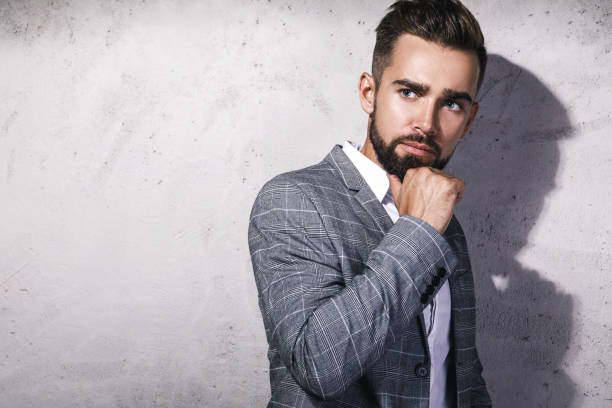 Handsome bearded man wearing gray suit stock photo