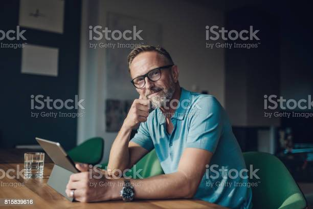 Handsome bearded midaged man at table with digital tablet picture id815839616?b=1&k=6&m=815839616&s=612x612&h=zbdlk2lbhp191u4 6bxwio0yksjqylaffz5e9avb5b8=