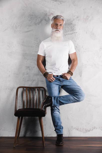 Handsome bearded senior man posing in studio stock photo