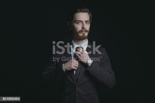 istock Handsome bearded stylish business man 824553454